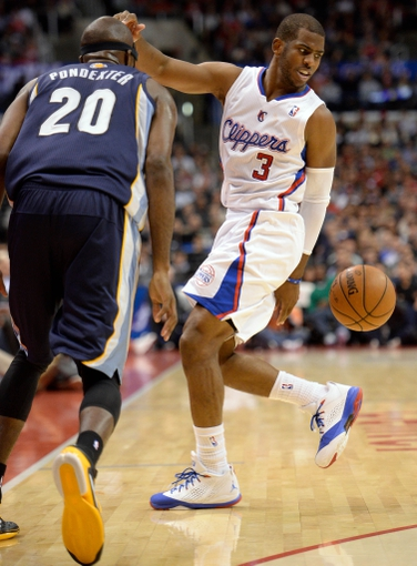 Nov 18, 2013; Los Angeles, CA, USA; Los Angeles Clippers point guard Chris Paul (3) gets fouled by Memphis Grizzlies small forward Quincy Pondexter (20) during second quarter action at Staples Center. Mandatory Credit: Robert Hanashiro-USA TODAY Sports