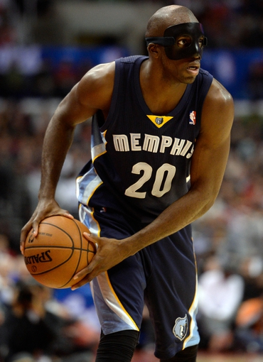 Nov 18, 2013; Los Angeles, CA, USA; The man behind the mask is Memphis Grizzlies small forward Quincy Pondexter (20) during second quarter action against the Los Angeles Clippers at Staples Center. Mandatory Credit: Robert Hanashiro-USA TODAY Sports