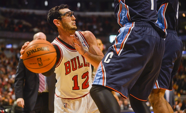 Nov 18, 2013; Chicago, IL, USA; Chicago Bulls shooting guard Kirk Hinrich (12) passes against the Charlotte Bobcats during the second half of their game at the United Center. The Bulls won 86-81. Mandatory Credit: Matt Marton-USA TODAY Sports