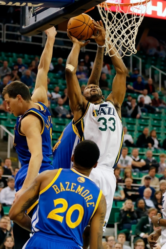 Nov 18, 2013; Salt Lake City, UT, USA; Utah Jazz small forward Mike Harris (33) tries to dunk the basketball while being guarded by 2 Golden State Warriors players during the fourth quarter at EnergySolutions Arena. Golden State Warriors won 98-87. Mandatory Credit: Chris Nicoll-USA TODAY Sports