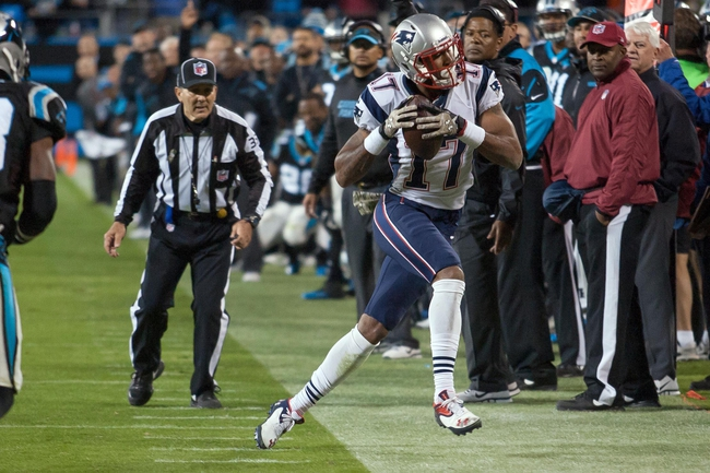 Nov 18, 2013; Charlotte, NC, USA; New England Patriots wide receiver Aaron Dobson (17) runs out of bounds during the fourth quarter against the Carolina Panthers at Bank of America Stadium. The Panthers defeated the Patriots 24-20. Mandatory Credit: Jeremy Brevard-USA TODAY Sports