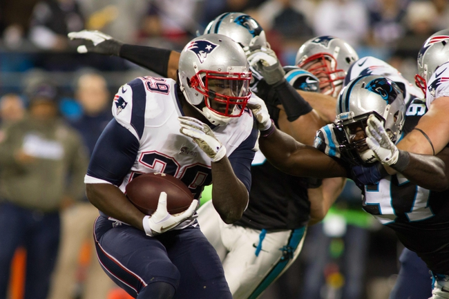 Nov 18, 2013; Charlotte, NC, USA; New England Patriots running back LeGarrette Blount (29) runs the ball during the fourth quarter against the Carolina Panthers at Bank of America Stadium. The Panthers defeated the Patriots 24-20. Mandatory Credit: Jeremy Brevard-USA TODAY Sports