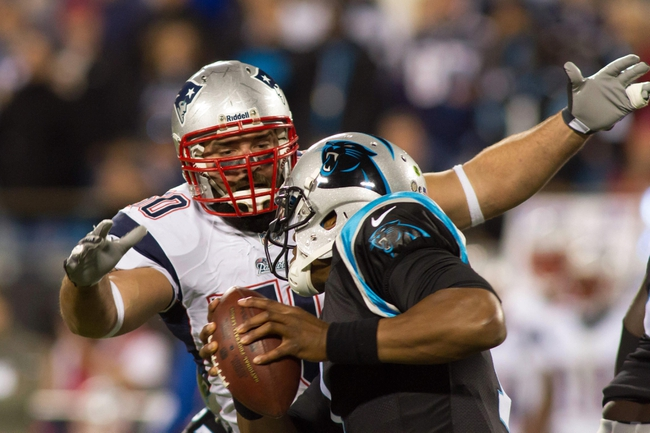 Nov 18, 2013; Charlotte, NC, USA; New England Patriots defensive end Rob Ninkovich (50) sacks Carolina Panthers quarterback Cam Newton (1) during the fourth quarter at Bank of America Stadium. The Panthers defeated the Patriots 24-20. Mandatory Credit: Jeremy Brevard-USA TODAY Sports