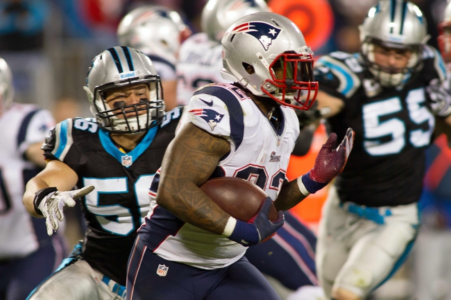 Nov 18, 2013; Charlotte, NC, USA; New England Patriots running back Stevan Ridley (22) runs the ball during the third quarter against the Carolina Panthers at Bank of America Stadium. The Panthers defeated the Patriots 24-20. Mandatory Credit: Jeremy Brevard-USA TODAY Sports