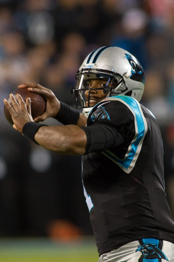 Nov 18, 2013; Charlotte, NC, USA; Carolina Panthers quarterback Cam Newton (1) throws a pass during the fourth quarter against the New England Patriots at Bank of America Stadium. The Panthers defeated the Patriots 24-20. Mandatory Credit: Jeremy Brevard-USA TODAY Sports