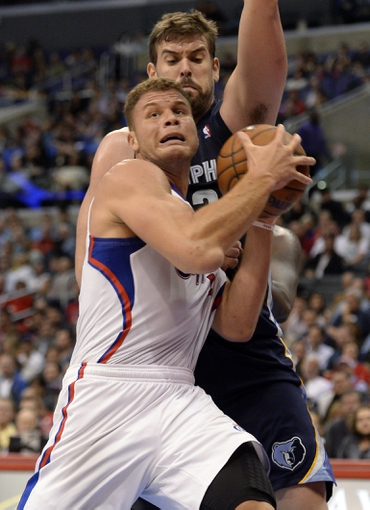 Nov 18, 2013; Los Angeles, CA, USA; Los Angeles Clippers power forward Blake Griffin (32) is defended by Memphis Grizzlies center Marc Gasol (33) during the third quarter at Staples Center. Mandatory Credit: Robert Hanashiro-USA TODAY Sports