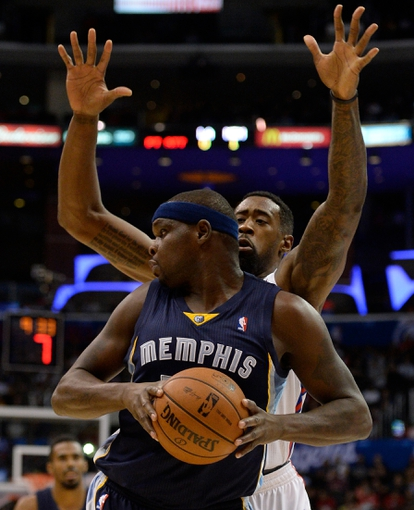 Nov 18, 2013; Los Angeles, CA, USA; Memphis Grizzlies power forward Zach Randolph (50) looks for a teammate to pass of to as Los Angeles Clippers center DeAndre Jordan (6) defends during the first half at Staples Center. Mandatory Credit: Robert Hanashiro-USA TODAY Sports