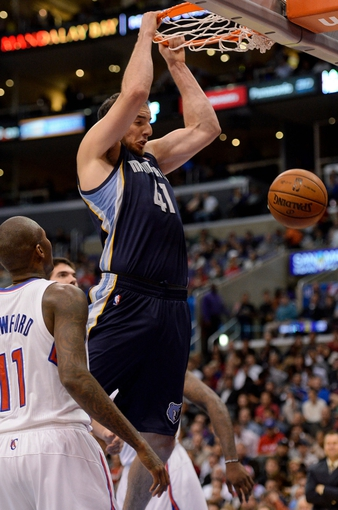 Nov 18, 2013; Los Angeles, CA, USA; Memphis Grizzlies center Kosta Koufos (41) dunks past Los Angeles Clippers shooting guard Jamal Crawford (11) during the first half at Staples Center. Mandatory Credit: Robert Hanashiro-USA TODAY Sports
