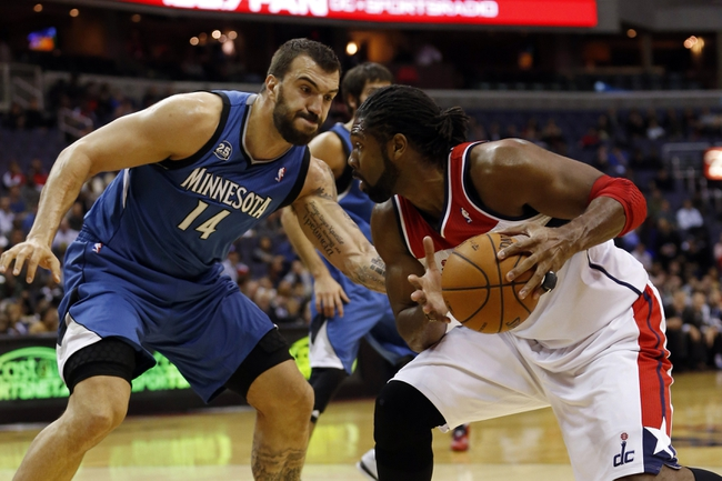 Nov 19, 2013; Washington, DC, USA; Washington Wizards power forward Nene Hilario (42) holds the ball as Minnesota Timberwolves center Nikola Pekovic (14) defends in the first quarter at Verizon Center. Mandatory Credit: Geoff Burke-USA TODAY Sports