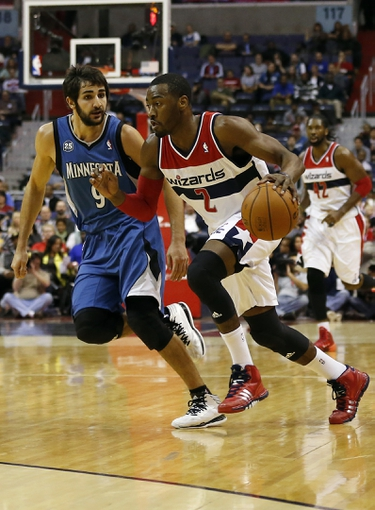 Nov 19, 2013; Washington, DC, USA; Washington Wizards point guard John Wall (2) dribbles the ball past Minnesota Timberwolves point guard Ricky Rubio (9) in the first quarter at Verizon Center. Mandatory Credit: Geoff Burke-USA TODAY Sports