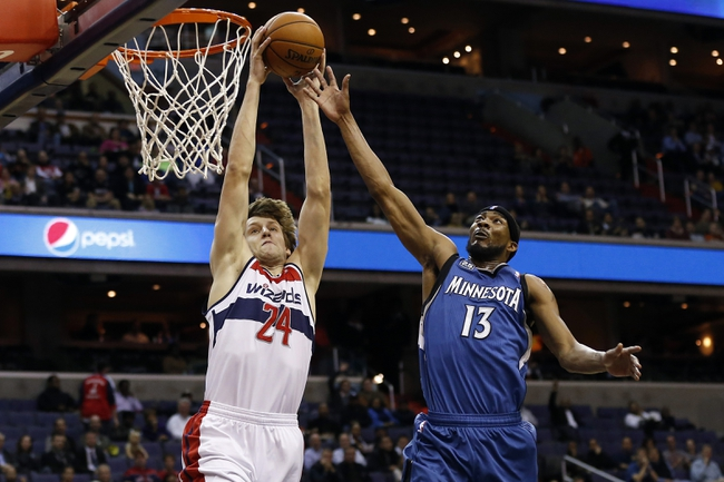 Nov 19, 2013; Washington, DC, USA; Washington Wizards power forward Jan Vesely (24) dunks the ball as Minnesota Timberwolves small forward Corey Brewer (13) defends in the second quarter at Verizon Center. Mandatory Credit: Geoff Burke-USA TODAY Sports