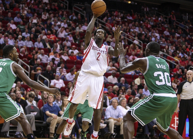 Nov 19, 2013; Houston, TX, USA; Houston Rockets point guard Patrick Beverley (2) shoots during the second quarter as Boston Celtics power forward Brandon Bass (30) defends at Toyota Center. Mandatory Credit: Troy Taormina-USA TODAY Sports