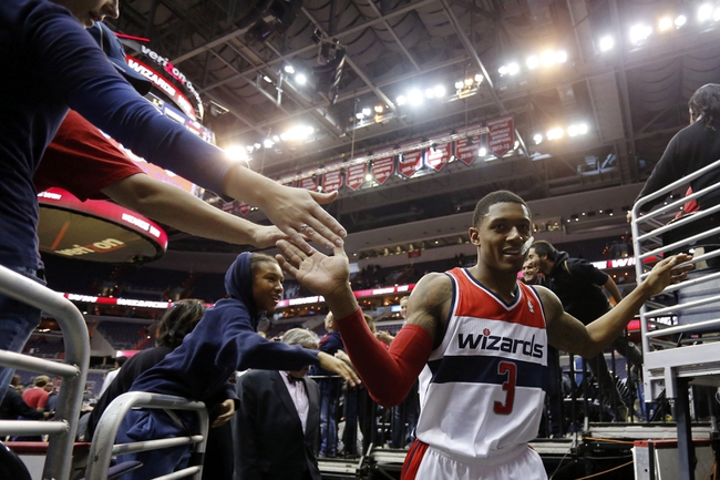Nov 19, 2013; Washington, DC, USA; Washington Wizards shooting guard Bradley Beal (3) shakes hands with fans after the Wizards' game against the Minnesota Timberwolves at Verizon Center. The Wizards won 104-100. Mandatory Credit: Geoff Burke-USA TODAY Sports