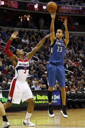 Nov 19, 2013; Washington, DC, USA; Minnesota Timberwolves shooting guard Kevin Martin (23) shoots the ball over Washington Wizards shooting guard Bradley Beal (3) in the third quarter at Verizon Center. The Wizards won 104-100. Mandatory Credit: Geoff Burke-USA TODAY Sports