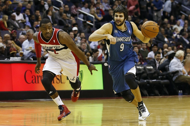Nov 19, 2013; Washington, DC, USA; Minnesota Timberwolves point guard Ricky Rubio (9) dribbles the ball as Washington Wizards point guard John Wall (2) defends in the third quarter at Verizon Center. The Wizards won 104-100. Mandatory Credit: Geoff Burke-USA TODAY Sports
