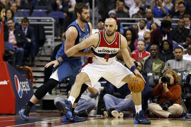 Nov 19, 2013; Washington, DC, USA; Washington Wizards center Marcin Gortat (4) dribbles the ball as Minnesota Timberwolves power forward Kevin Love (42) defends in the fourth quarter at Verizon Center. The Wizards won 104-100. Mandatory Credit: Geoff Burke-USA TODAY Sports