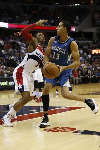 Nov 19, 2013; Washington, DC, USA; Minnesota Timberwolves shooting guard Kevin Martin (23) dribbles the ball as Washington Wizards shooting guard Bradley Beal (3) defends in the fourth quarter at Verizon Center. The Wizards won 104-100. Mandatory Credit: Geoff Burke-USA TODAY Sports