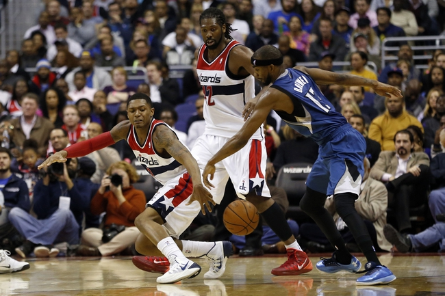 Nov 19, 2013; Washington, DC, USA; Washington Wizards shooting guard Bradley Beal (3) and Minnesota Timberwolves small forward Corey Brewer (13) battle for the ball in the fourth quarter at Verizon Center. The Wizards won 104-100. Mandatory Credit: Geoff Burke-USA TODAY Sports