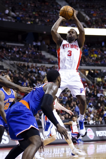 Nov 19, 2013; Auburn Hills, MI, USA; Detroit Pistons shooting guard Rodney Stuckey (3) shoots in the third quarter against the New York Knicks at The Palace of Auburn Hills. Detroit 92-86. Mandatory Credit: Rick Osentoski-USA TODAY Sports
