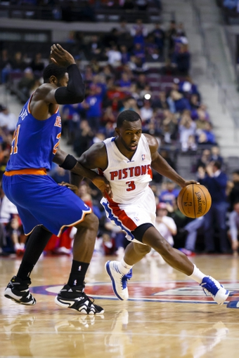 Nov 19, 2013; Auburn Hills, MI, USA; Detroit Pistons shooting guard Rodney Stuckey (3) moves the ball defended by New York Knicks shooting guard Iman Shumpert (21) in the fourth quarter at The Palace of Auburn Hills. Detroit 92-86. Mandatory Credit: Rick Osentoski-USA TODAY Sports