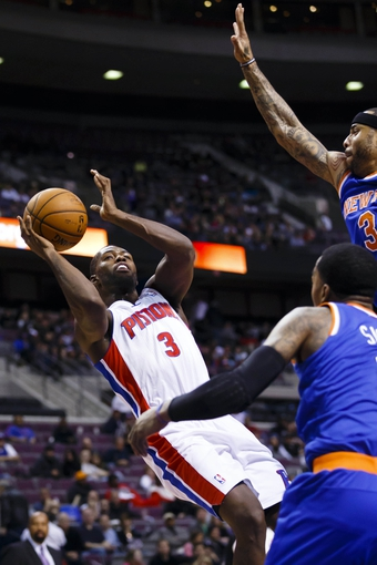 Nov 19, 2013; Auburn Hills, MI, USA; Detroit Pistons shooting guard Rodney Stuckey (3) shoots on New York Knicks power forward Kenyon Martin (3) in the fourth quarter at The Palace of Auburn Hills. Mandatory Credit: Rick Osentoski-USA TODAY Sports