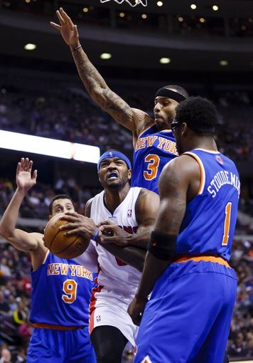 Nov 19, 2013; Auburn Hills, MI, USA; Detroit Pistons small forward Josh Smith (6) tries to shoot on New York Knicks power forward Amar'e Stoudemire (1) and power forward Kenyon Martin (3) in the fourth quarter at The Palace of Auburn Hills. Detroit 92-86. Mandatory Credit: Rick Osentoski-USA TODAY Sports