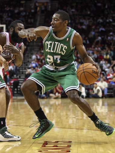 Nov 19, 2013; Houston, TX, USA; Boston Celtics shooting guard Jordan Crawford (27) controls the ball during the third quarter against the Houston Rockets at Toyota Center. Mandatory Credit: Troy Taormina-USA TODAY Sports