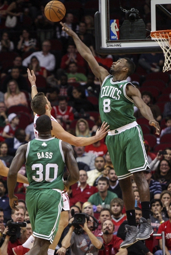 Nov 19, 2013; Houston, TX, USA; Boston Celtics shooting guard Jeff Green (8) blocks a shot by Houston Rockets small forward Chandler Parsons (25) during the third quarter at Toyota Center. Mandatory Credit: Troy Taormina-USA TODAY Sports