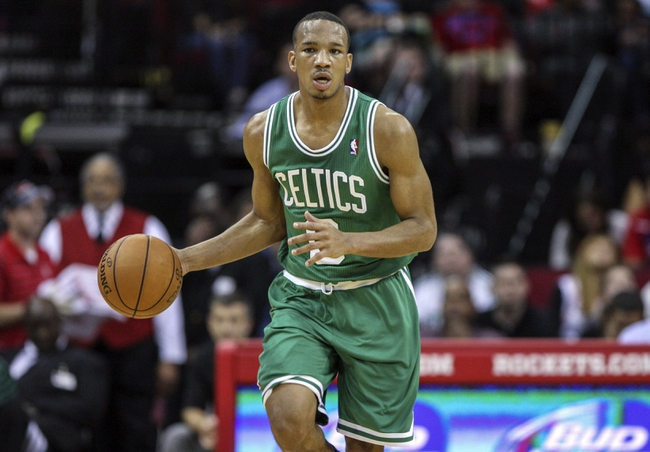 Nov 19, 2013; Houston, TX, USA; Boston Celtics point guard Avery Bradley (0) brings the ball up the court during the third quarter against the Houston Rockets at Toyota Center. Mandatory Credit: Troy Taormina-USA TODAY Sports