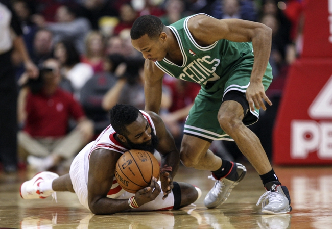 Nov 19, 2013; Houston, TX, USA; Houston Rockets shooting guard James Harden (13) and Boston Celtics point guard Avery Bradley (0) battle for a loose ball during the third quarter at Toyota Center. Mandatory Credit: Troy Taormina-USA TODAY Sports