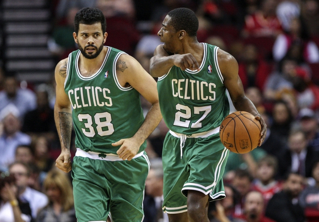 Nov 19, 2013; Houston, TX, USA; Boston Celtics shooting guard Jordan Crawford (27) directs center Vitor Faverani (38) during the third quarter against the Houston Rockets at Toyota Center. Mandatory Credit: Troy Taormina-USA TODAY Sports