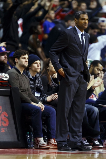 Nov 19, 2013; Auburn Hills, MI, USA; Film actors Justin Bartha (left) and Jesse Eisenberg (right) watch the game behind Detroit Pistons head coach Maurice Cheeks against the New York Knicks at The Palace of Auburn Hills. Mandatory Credit: Rick Osentoski-USA TODAY Sports