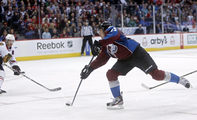 Nov 19, 2013; Denver, CO, USA; Colorado Avalanche right wing PA Parenteau (15) scores a goal during the second period against the Chicago Blackhawks at Pepsi Center. Mandatory Credit: Chris Humphreys-USA TODAY Sports