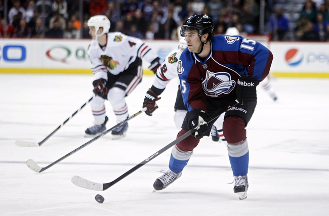 Nov 19, 2013; Denver, CO, USA; Colorado Avalanche right wing PA Parenteau (15) skates with the puck before scoring a goal during the second period against the Chicago Blackhawks at Pepsi Center. Mandatory Credit: Chris Humphreys-USA TODAY Sports
