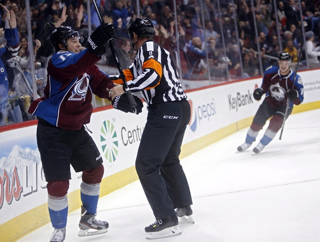 Nov 19, 2013; Denver, CO, USA; Colorado Avalanche right wing PA Parenteau (15) reacts after scoring a goal during the second period against the Chicago Blackhawks at Pepsi Center. Mandatory Credit: Chris Humphreys-USA TODAY Sports