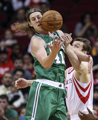 Nov 19, 2013; Houston, TX, USA; Boston Celtics center Kelly Olynyk (41) and Houston Rockets center Omer Asik (3) battle for the ball during the fourth quarter at Toyota Center. The Rockets defeated the Celtics 109-85. Mandatory Credit: Troy Taormina-USA TODAY Sports