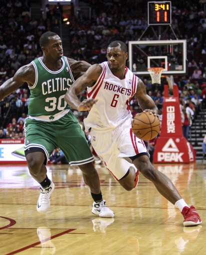 Nov 19, 2013; Houston, TX, USA; Houston Rockets power forward Terrence Jones (6) drives the ball during the second quarter as Boston Celtics power forward Brandon Bass (30) defends at Toyota Center. Mandatory Credit: Troy Taormina-USA TODAY Sports