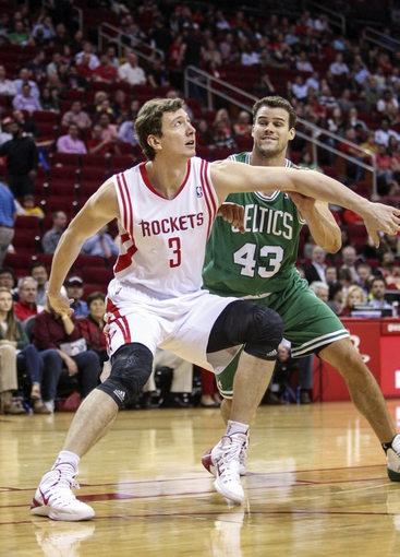 Nov 19, 2013; Houston, TX, USA; Houston Rockets center Omer Asik (3) defends Boston Celtics power forward Kris Humphries (43) during the fourth quarter at Toyota Center. The Rockets defeated the Celtics 109-85. Mandatory Credit: Troy Taormina-USA TODAY Sports