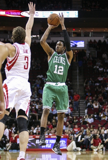 Nov 19, 2013; Houston, TX, USA; Boston Celtics shooting guard MarShon Brooks (12) shoots during the fourth quarter against the Houston Rockets at Toyota Center. The Rockets defeated the Celtics 109-85. Mandatory Credit: Troy Taormina-USA TODAY Sports