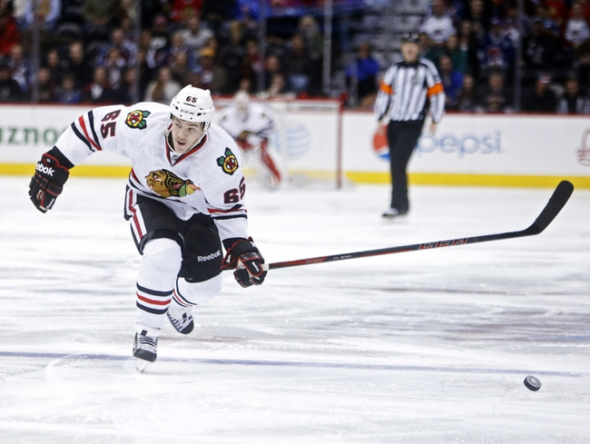 Nov 19, 2013; Denver, CO, USA; Chicago Blackhawks center Andrew Shaw (65) chases down the puck during the third period against the Colorado Avalanche at Pepsi Center. The Avalanche won 5-1. Mandatory Credit: Chris Humphreys-USA TODAY Sports