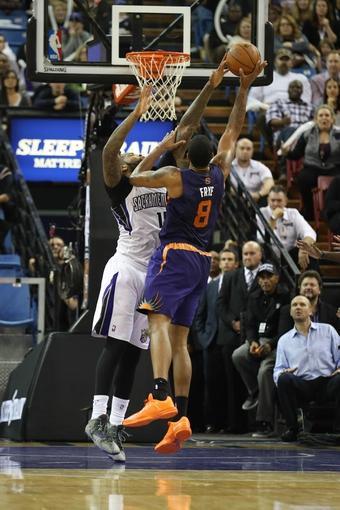 Nov 19, 2013; Sacramento, CA, USA; Sacramento Kings center DeMarcus Cousins (15) blocks the shot by Phoenix Suns power forward Channing Frye (8) during the fourth quarter at Sleep Train Arena. The Sacramento Kings defeated the Phoenix Suns 107-104. Mandatory Credit: Kelley L Cox-USA TODAY Sports