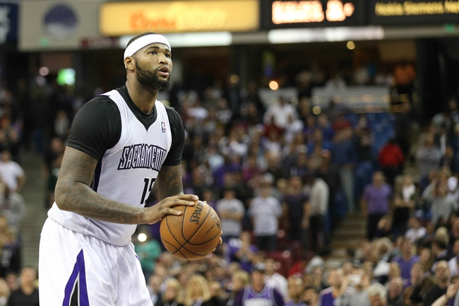 Nov 19, 2013; Sacramento, CA, USA; Sacramento Kings center DeMarcus Cousins (15) shoots a free throw to give the Kings a three point lead against the Phoenix Suns with 0.8 seconds on the clock during the fourth quarter at Sleep Train Arena. The Sacramento Kings defeated the Phoenix Suns 107-104. Mandatory Credit: Kelley L Cox-USA TODAY Sports