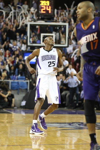 Nov 19, 2013; Sacramento, CA, USA; Sacramento Kings small forward Travis Outlaw (25) reacts after scoring a basket against the Phoenix Suns during the fourth quarter at Sleep Train Arena. The Sacramento Kings defeated the Phoenix Suns 107-104. Mandatory Credit: Kelley L Cox-USA TODAY Sports