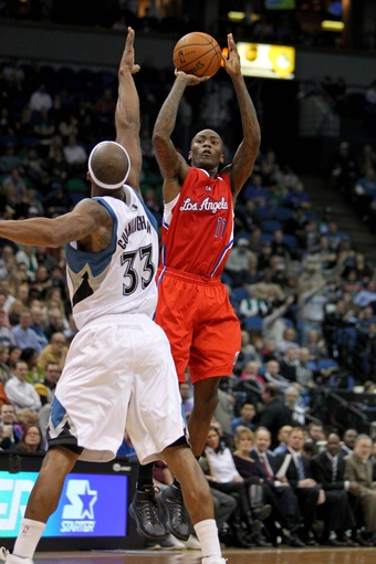Nov 20, 2013; Minneapolis, MN, USA; Los Angeles Clippers guard Jamal Crawford (11) shoots over Minnesota Timberwolves forward Dante Cunningham (33) during the second quarter at Target Center. Mandatory Credit: Brace Hemmelgarn-USA TODAY Sports