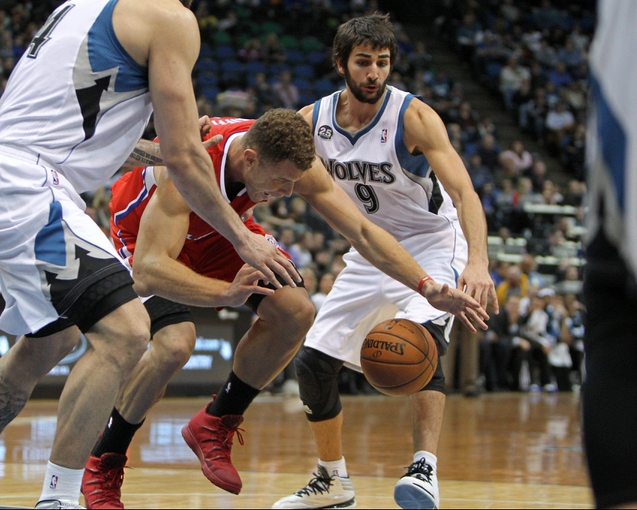 Nov 20, 2013; Minneapolis, MN, USA; Los Angeles Clippers forward Blake Griffin (32) is guarded by Minnesota Timberwolves guard Ricky Rubio (9) during the second quarter at Target Center. Mandatory Credit: Brace Hemmelgarn-USA TODAY Sports