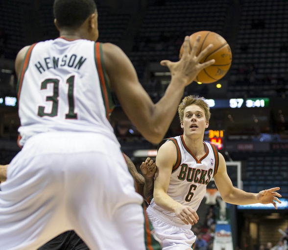 Nov 20, 2013; Milwaukee, WI, USA; Milwaukee Bucks forward John Henson (31) passes the ball to guard Nate Wolters (6) during the third quarter against the Portland Trail Blazers at BMO Harris Bradley Center. Mandatory Credit: Jeff Hanisch-USA TODAY Sports
