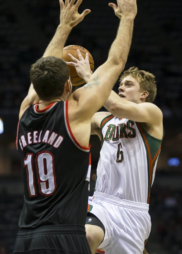 Nov 20, 2013; Milwaukee, WI, USA; Milwaukee Bucks guard Nate Wolters (6) shoots against Portland Trail Blazers center Joel Freeland (19) during the third quarter at BMO Harris Bradley Center. Mandatory Credit: Jeff Hanisch-USA TODAY Sports