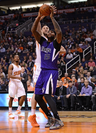 Nov 20, 2013; Phoenix, AZ, USA; Sacramento Kings center DeMarcus Cousins (15) is fouled by Phoenix Suns forward Miles Plumlee (22) in the first half at US Airways Center. Mandatory Credit: Jennifer Stewart-USA TODAY Sports