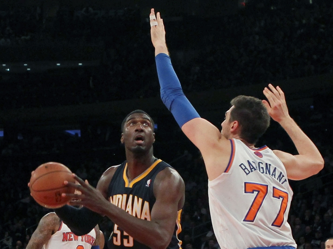 Nov 20, 2013; New York, NY, USA; Indiana Pacers center Roy Hibbert (55) shoots past New York Knicks power forward Andrea Bargnani (77) during the fourth quarter at Madison Square Garden. The Pacers defeated the Knicks 103-96 in overtime. Mandatory Credit: Brad Penner-USA TODAY Sports