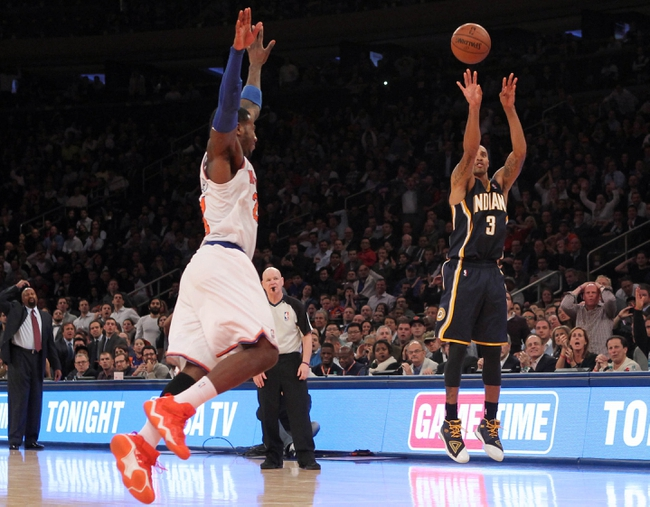 Nov 20, 2013; New York, NY, USA; Indiana Pacers point guard George Hill (3) shoots over New York Knicks shooting guard Iman Shumpert (21) and New York Knicks during the fourth quarter at Madison Square Garden. The Pacers defeated the Knicks 103-96 in overtime. Mandatory Credit: Brad Penner-USA TODAY Sports